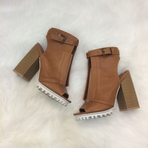 Chunky Sandal With Block Heel Brown leather with buckle closure. Like new!! Super comfy and stylish. Still debating on selling! Shoes