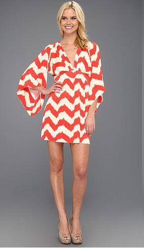 I could wear this with leggings and boots. Love the large sleeves.  So cute!
