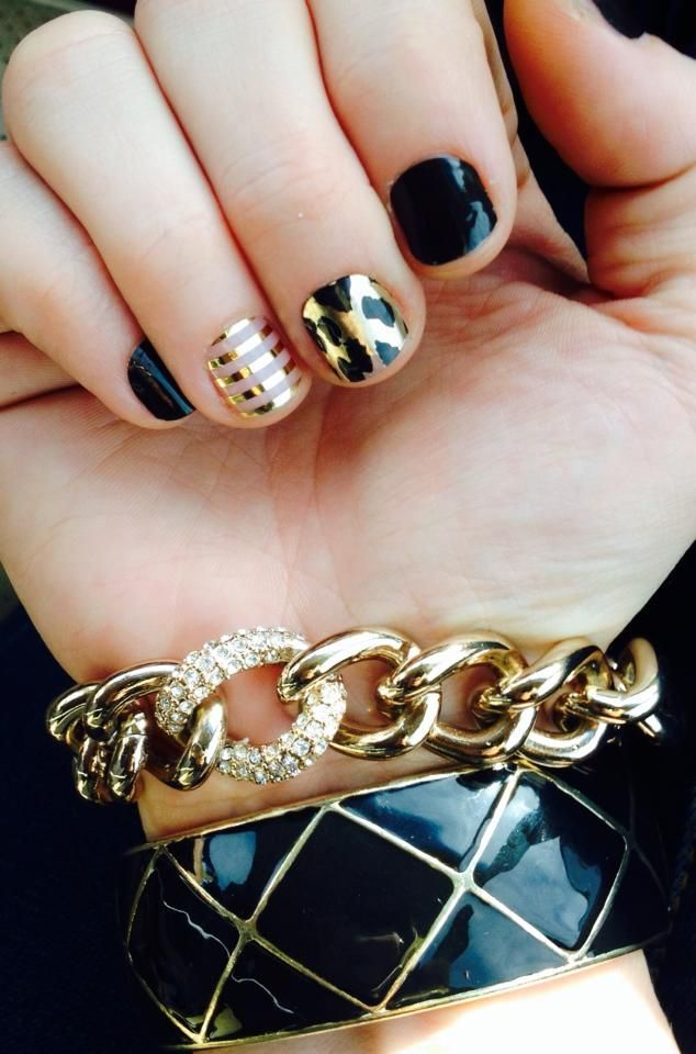 Black, gold stripe, and leopard nails.