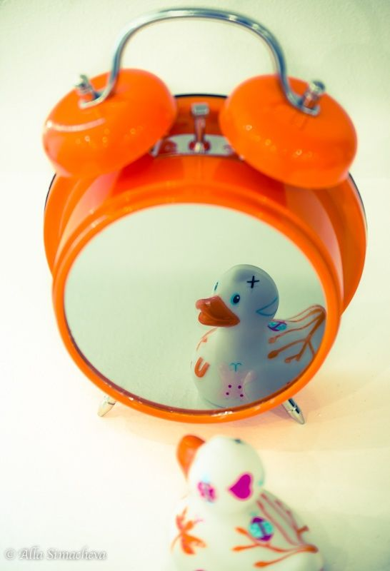 Retro clock with a mirror. Don't forget to match one rubber duck with your interior!
