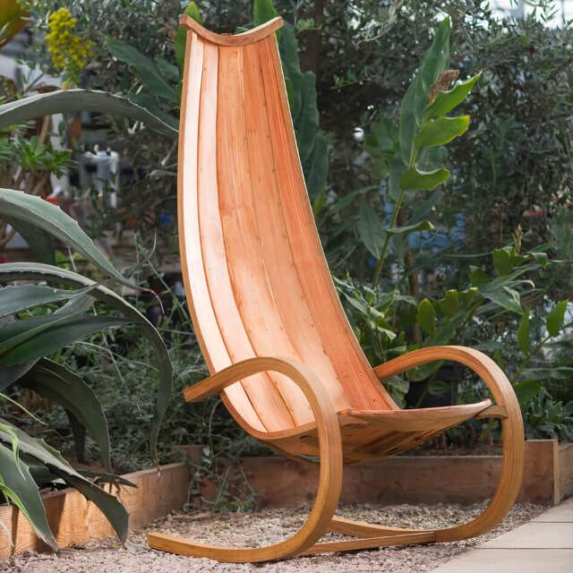 Carl Austin - RANCH rocking chair  £1650.00  Designed as a statement piece of furniture that you can pass lazy sunny or cosy fire side days in.  Made of steam bent & laminated oak with larch planks, this chair is built using exactly the same methods & materials that would be found on a traditionally built wooden boat. As such, it is equally suited to the patio or indoors.  Carl has spent 25 years working at furniture design alongside wooden boat building. This chair is part of a range that…