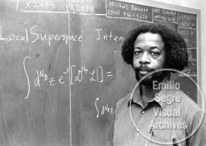 Sylvester James Gates pictured at chalkboard.