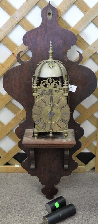 Brass skelton clock with chime dome top, brass works, and mahogany wall shelf ~ Realized Price $2,280.00  #nadeausauction