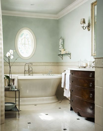 Elegant Chic Neutral Bathroom, Love The Soft Color On The Walls, Oval Window,  Bathtub, Floor And The Dark Wood Vanity Sink.