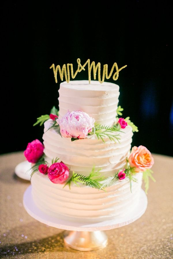 Ruffled Wedding Cake with Fresh Flowers and a Gold Calligraphy Cake Topper | Jordan Brittley Photography | http://heyweddinglady.com/whimsical-kate-spade-wedding-black-tie/