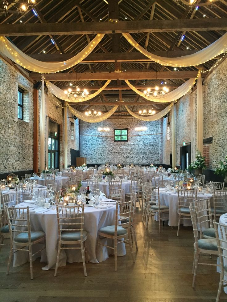 Granary barn wedding breakfast #granaryestates #granarybarn #barnweddings #fairylights #drapes #ledwalllights