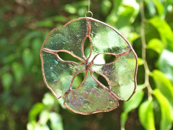 Iridescent stained glass sand dollar suncatcher by ArdsleyArtGlass, $100.00