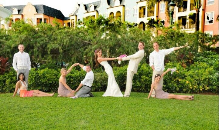 Cute wedding party picture, bridesmaids and groomsmen help spell love