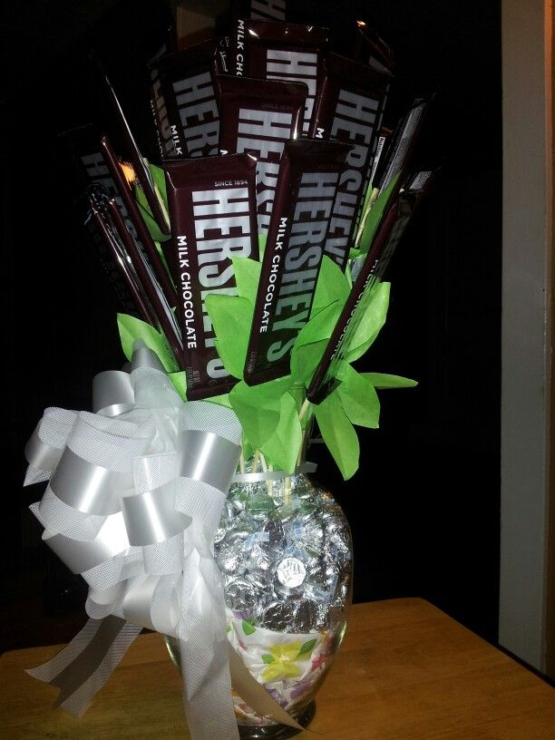 made with hershey bars hot glued to skewers with green tissue paper leaves put in a vase stuffed with hershey kisses