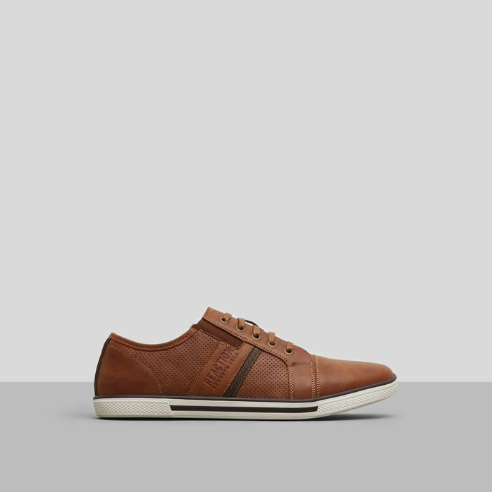 Low-top sneaker    Cap toe design    Waxed laces    Perforated detail on tongue and upper    Faux leather lining and upper    Treaded rubber sole    Imported