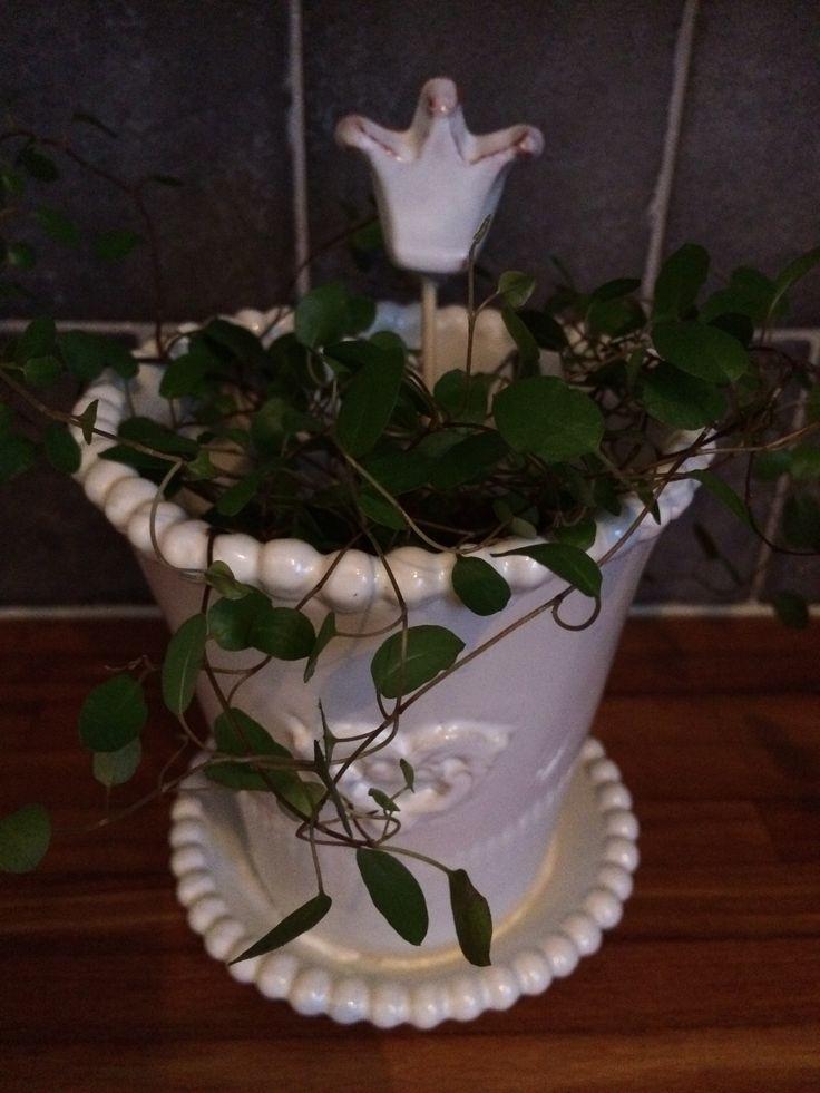 Floral stick with princess crown. Handmade ceramic