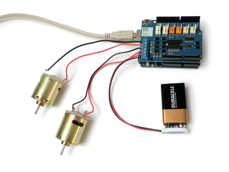 Using the *Arduino Motor Shield* to interface with 2 DC motors http://www.instructables.com/id/Arduino-Motor-Shield-Tutorial/step5/Two-Motors