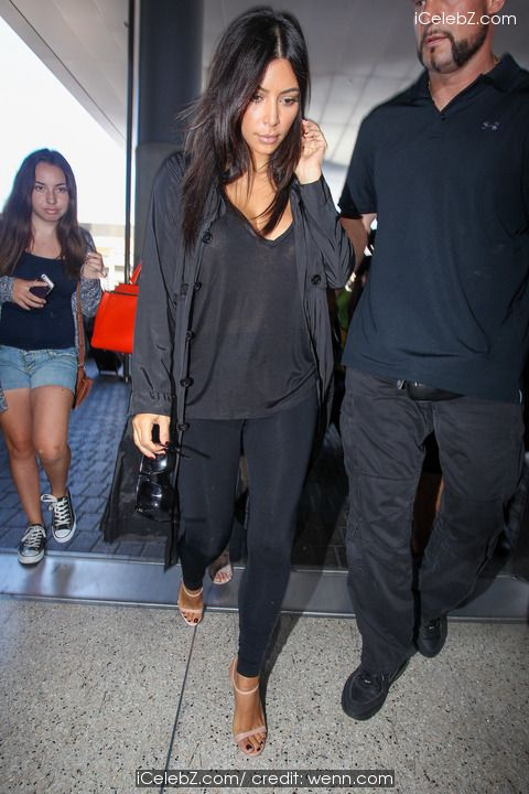 Kim Kardashian, Kendall Jenner and Kris Jenner at Los Angeles International Airport (LAX) http://icelebz.com/events/kendall_jenner_kris_jenner_and_kim_kardashian_at_los_angeles_international_airport_lax_/photo4.html