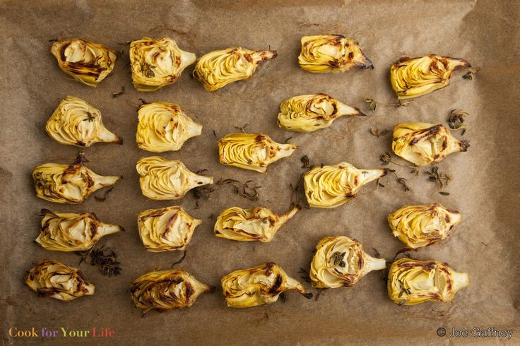 These simple roasted artichoke hearts are an easy, tasty side dish, a great topping for pizza, or delicious tossed into a salad with some olives.