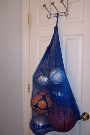 Dollar Store laundry bag ball storage for the win. :)