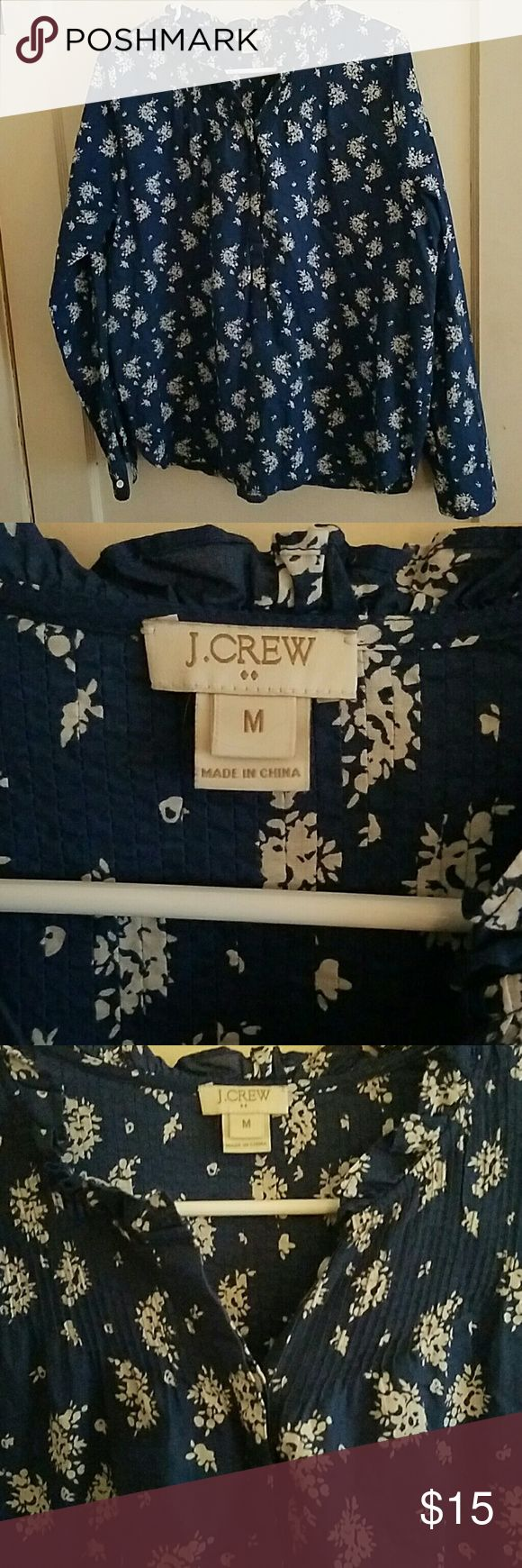 J. Crew floral blue shirt Adorable j. Crew floral blouse. Top and back is smocked. Has 4 buttons in front. Long cuffed sleeves with button. Dark blue with white flowers. Size medium. J. Crew Tops Blouses