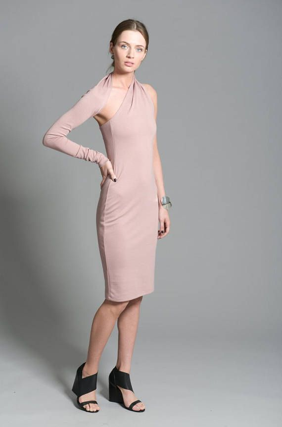 One shoulder dress with a twist. Elegant, unique, versatile, the dress is structured so that the sleeve flips around the neck and can be worn on either arm. Brought by popular demand, were happy to now present the pencil, midi length version of this timeless piece. Chic and elegant, the