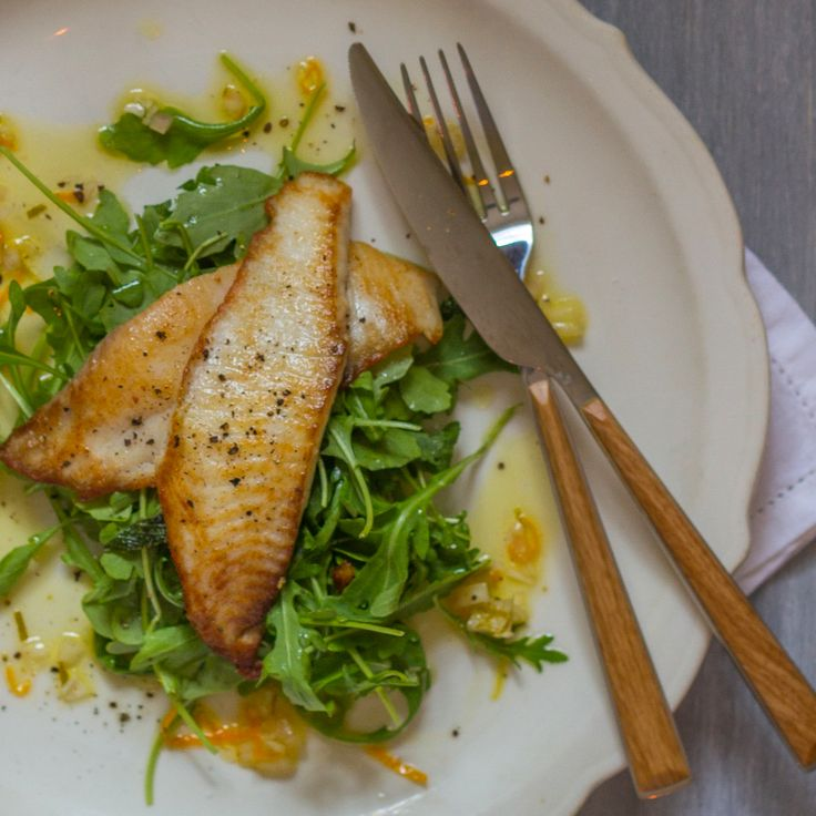 Perfect for lunch or a light dinner, this tilapia recipe is served over a crisp arugula salad and is ready in just 15 minutes.