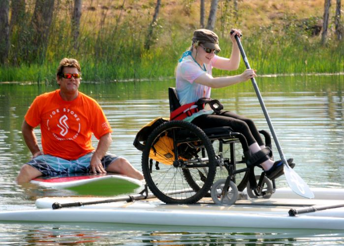 FRENCHTOWN POND – As a group of wheelchair users met here to try paddleboarding on adaptive boards, quadriplegic athlete Joe Stone watched from the dock. >>> See it. Believe it. Do it. Watch thousands of SCI videos at SPINALpedia.com