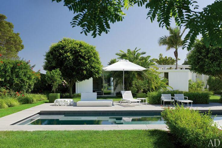 The poolside terrace at designer Abigail Turin's midcentury home in Carpinteria, California.