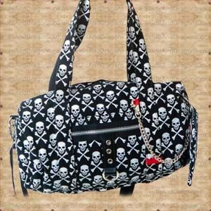 White skulls and crossbones cover this one of a kind skull bag. The versatile design provides handy carry straps, or a detachable shoulder strap for your convenience. Included is a simple matching purse. The Skull Print Duffel Bag and Purse by Queen of Darkness in the Skulls and Dragons bag range.    Ref : SDABA29908   Price : 34.99 GBP