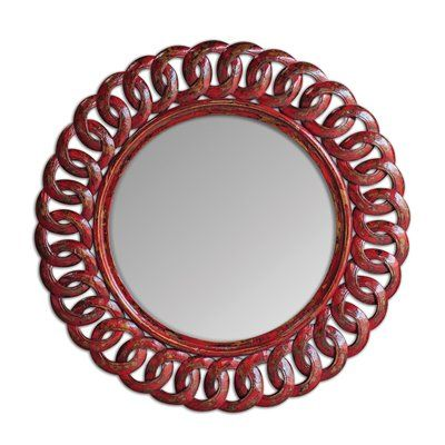Uttermost 05029 Sassia Red Round Decorative Mirror  Sassia Red Round Decorative MirrorFrame is made from carved, solid mango wood finished in heavily di…