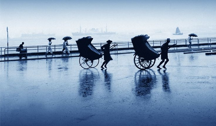 Rickshaws in rain by Fan Ho