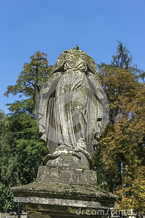 Mother of God without head on the Tomb in Rakowicki cemetary in Krakow.