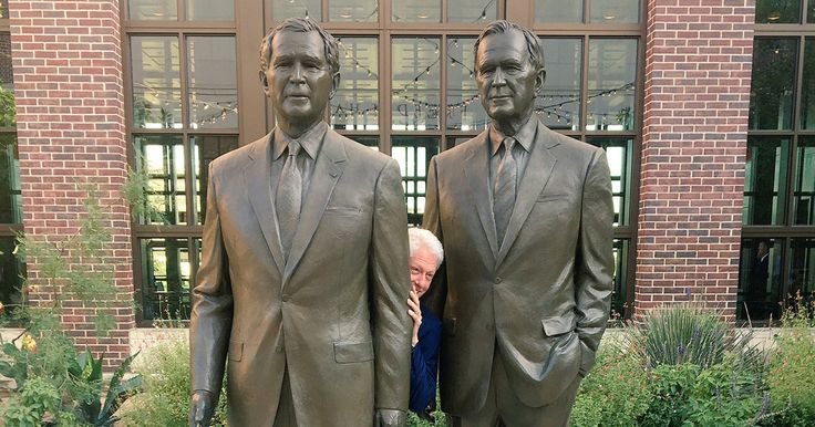 In a new viral photo, former President Bill Clinton posed between statues of his predecessor, George H.W. Bush, and successor, George W. Bush, at the George W. Bush Presidential Library in Texas