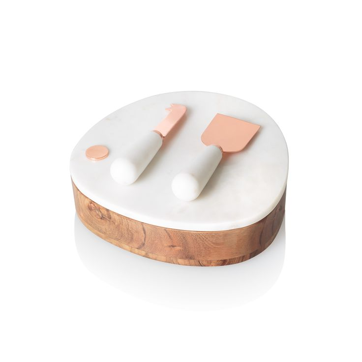 Buy the Marble Pebble Cheese Board with Set of Two Knives at Oliver Bonas. Enjoy free UK standard delivery for orders over £50.