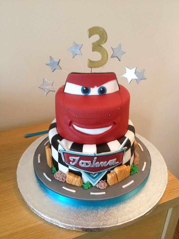 This is the cake. with a happier face and no rocks at the bottom instead have cones, tires, and route 66.