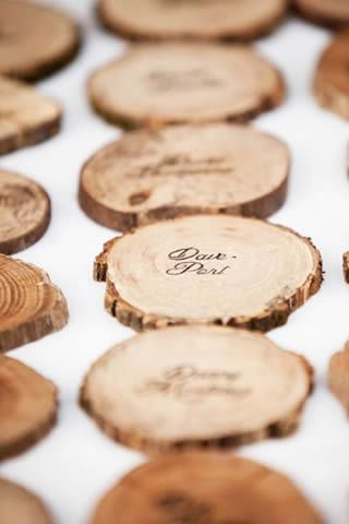 Wooden coasters with name and table number as seating chart and wedding favours