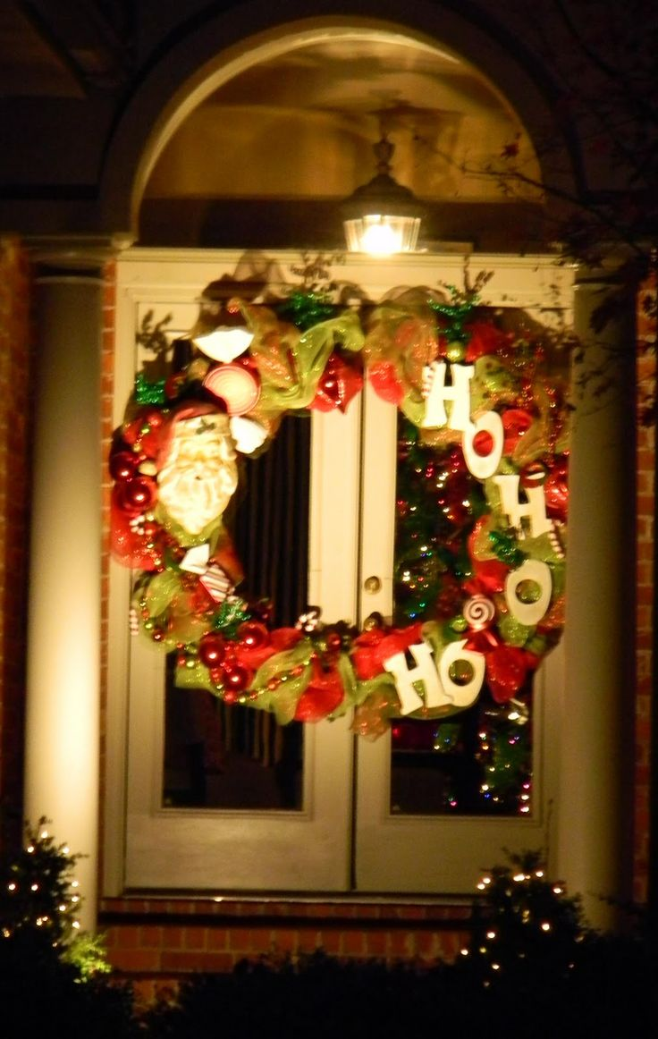Let the Christmas Door stalking of 2011 begin! This is a creative approach to double doors - an extra large wreath cut in half and placed on each door. Brilliant! This one is super cute to boot. I love Santa on one side and HO HO HO on the other.