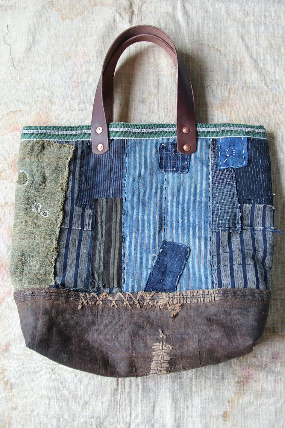 Boro tote bag , made of japanese indigodyed cotton,vintage japanese kasuri and japanese noragi textile, kaya textile with a lot of vintage japanese textiles. entirely hand sewn and hand knitted in cotton and linen twine. but inside and upper, buttom is machinesewing. Bound is japanese vintage maekake apron webbing This sewn machine. buttom is made from vintage sashiko stitched sakabukuro. the Inside lining is made of cotton obi-shin. It have 2 big pockers. pockets are made of vintage japa...
