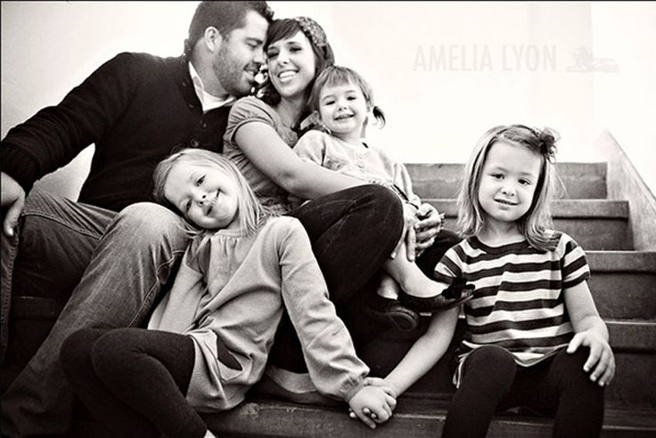 50 Outstanding Examples Of Family Photography | AntsMagazine.Com - - - parents 3kids, multi level on stairs, two oldest kids holding hanfd