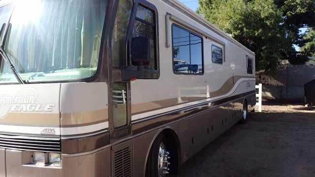 1994 Used Fleetwood American Eagle Class A in California CA.Recreational Vehicle, rv, 1994 Fleetwood American Eagle , For Sale - American Eagle Motorhome. Marble flooring, Corian counter tops, leather couch and chair. Beautiful solid wood cabinets in excellent shape. Large stand up shower, Queen size walk around bed, Microwave, 20lb. under counter ice maker (new), wine rack and counter top blender. Floor safe in cedar lined closet. Washer/dryer combo. In motion King Dome satellite with two…