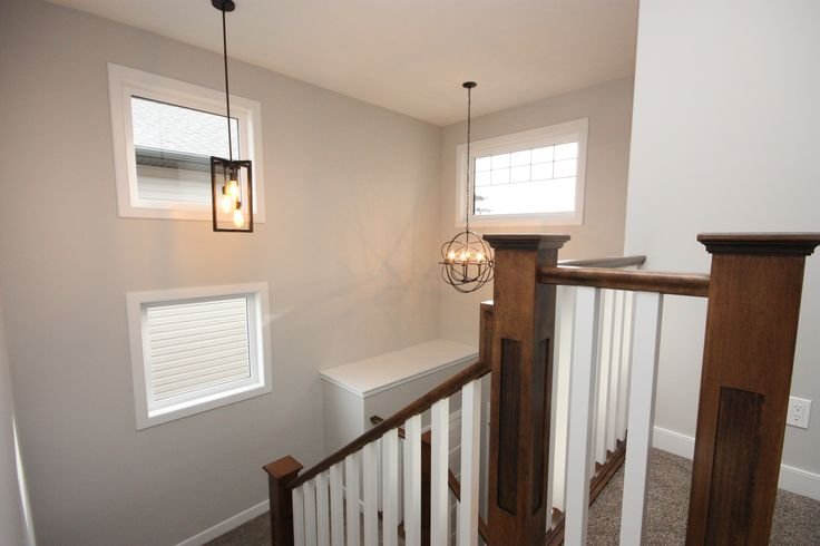 2 storey tall ceiling, maple end posts, natural light, windows, staircase
