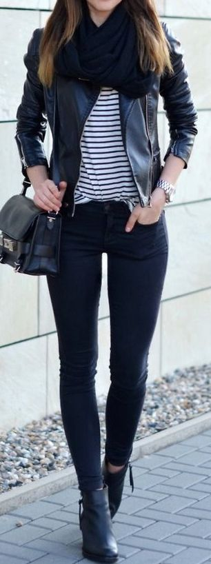 black faux leather jacket, black and white striped top, black pants, black booties, black scarf
