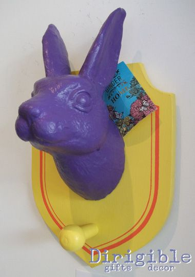 This proud purple rabbit is sure to stand out amongst your coats.