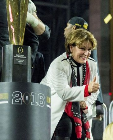 Mrs. Terry gives her family a thumbs up as Alabama celebrates after their 45-40 victory over Clemson in the College Football Playoff National Championship football game, Monday, Jan. 11, 2016, at University of Phoenix Stadium in Glendale, Ariz.