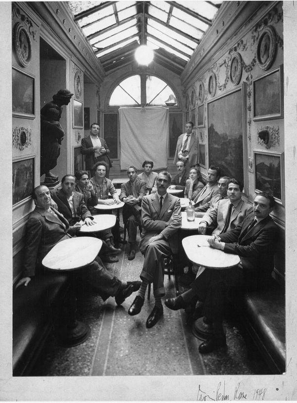 """""""Group at Caffè Greco in Rome"""" (1948) photo by Irving Penn.   From left: Aldo Palazzeschi, Goffredo Petrassi, Mirko, Carlo Levi, Pericle Fazzini, Afro, Renzo Vespignani, Libero De Libero, Sandro Penna, Lea Padovani, Orson Welles, Mario Mafai, Ennio Flajano, Vitaliano Brancati, Orfeo Tamburi (in the middle)."""