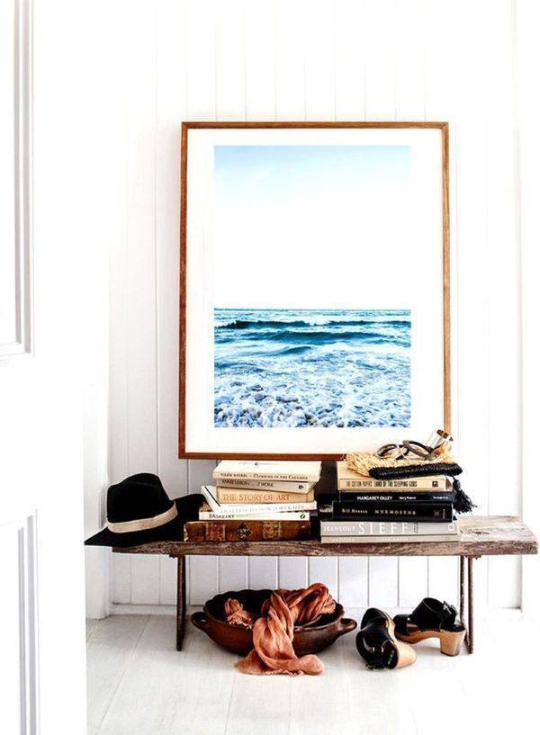 entryway styling with wooden bench and oversized art
