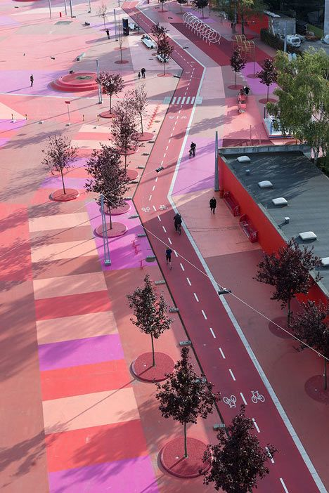 Superkilen by BIG, Topotek1 and Superflex:  scattered miscellaneous street furniture from 60 different nations across a brightly coloured carpet of grass and rubber at this park in Copenhagen
