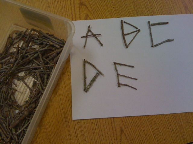 Making letters with twigs