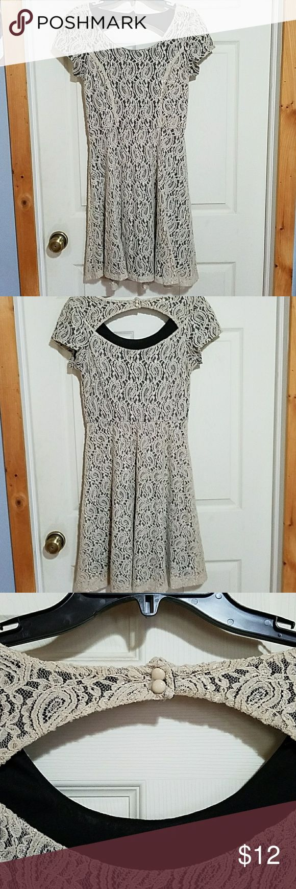 Maurices Cream Lace & Black dress Maurices black dress with a cream lace overlay.  Short sleeves with an open upper back that buttons. Looks great with a belt. There is a small hole in the lace where my necklace caught on it which is shown in the last picture. If you are handy with needle and thread, this could easily be fixed. Size 5/6 and fits like a medium. I've worn it about 5 times, with the last time being last fall. Maurices Dresses Midi
