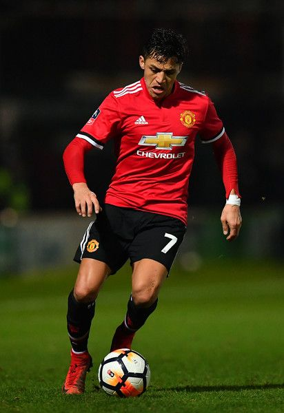 Alexis Sanchez Photos - Alexis Sanchez of Manchester United controls the ball during the Emirates FA Cup Fourth Round match between Yeovil Town and Manchester United at Huish Park on January 26, 2018 in Yeovil, England. - Yeovil Town v Manchester United - The Emirates FA Cup Fourth Round