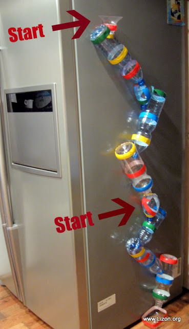 Marble run made with plastic bottles from recycling bin. You cut the bottoms off the bottles - I wonder if the cut edges would scrape hands? Maybe seal off with tape.