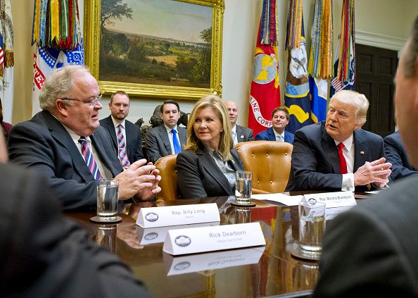 """United States President Donald J. Trump participates in a """"Congressional listening session"""" in the Roosevelt Room of the White House in Washington, DC on Thursday, February 16, 2017. From left to right: US Representative Billy Long (Republican of Missouri), US Representative Marsha Blackburn (Republican of Tennessee), and the President. Credit: Ron Sachs / Pool via CNP"""
