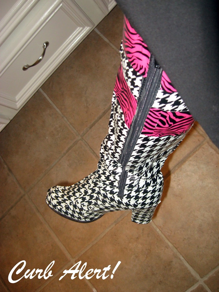 why did I never think of this! Get a pair of black boots then with the magic of duct tape, WONDERWOMAN BOOTS. So much cheaper than custom buy ones lol