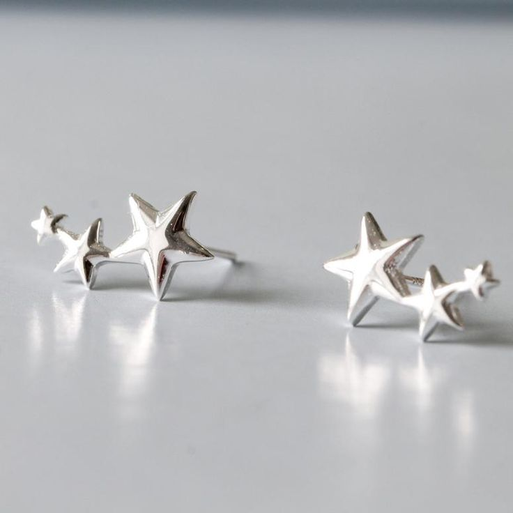 Cute rising star ear studs - simple and elegant - made in sterling silver with a polished finish.    Silver is timelessly classic, and this design has combined classic and contemporary styles. Just the perfect gift for someone who loves star designs. Also a gorgeous present for Mother's Day, Valentine's Day, presents for bridesmaids or birthdays, Christmas or just a gift to yourself.